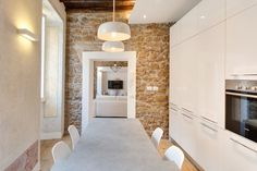 http://www.idesignarch.com/charming-apartment-in-rome-with-old-wood-structure-and-stone-walls/