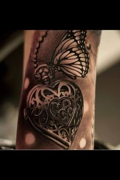 Beautiful #InkedMagazine #locket #butterfly #tattoo #tattoos #Inked #ink #art