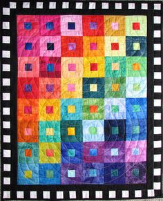 Batik Rainbow by Lisa-S    Explore #303    I finally decided on a concentric circle pattern. I'm quite pleased with the results. Instead of marking it I cut out circles from freezer paper, ironed them on, and quilted around them. It went quite quickly but is difficult to keep a smooth arc when stopping and starting. Easy Quilts, Scrappy Quilts, Patchwork Quilting, Batik Quilts, Jellyroll Quilts, Strip Quilts, Square Quilt, Circle Pattern, Freezer Paper