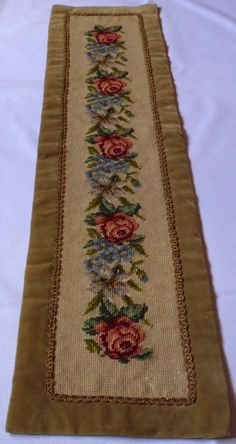 Lovely vintage handmade tapestry / table runner with Roses. Hand embroidery there is a decorative gold tape and velvet all around very precise work At the back there is a lining. In an excellent vintage condition with one tiny pale spot (last photo) Approximate measurements: 9,5 x 38,2 (24