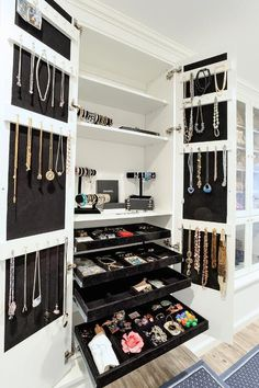 Chic closet features a double door cabinet, with inside of cabinet doors lined with stacked ... #customclosets