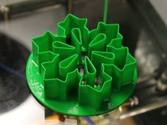 A snowflake cutter.  Designed for making snowflake soaps, it's also fine for cookies.  I also made a thing for pushing the soap/dough out of the cutter if it gets stuck inside.  It saves a lot of time over poking it out with a q-tip or something.