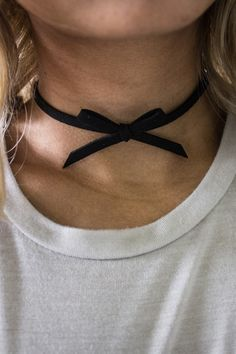 Vegan suede bow choker with an adjustable lobster clasp closure. Style #: TakeABowChoker Color: Black Material: Polyurethane One Size Width: 0.5 cm Length: 33 cm plus extender chain
