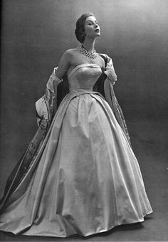 1953 Model Myrtle Crawford shows us a glamorous Givenchy designed dress-and-coat ensemble of taffeta.