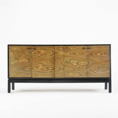 Broyhill credenza  USA, c. 1975  walnut, wavy-grained plywood, lacquered wood, brass