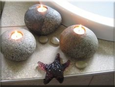 rock candles. Just drill a hole in river rocks and set in candles... LOVE THIS!