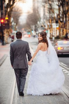 bride and groom walking down the streets of Portland.