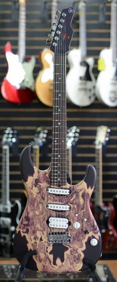 James Tyler Guitars... like the body, but can't tell if it's a finish or natural wood