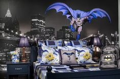 Designer: TRIO Environments, Denver, CO A boys bedroom that has been dedicated to Batman! This cityscape wall mural is the perfect backdrop for the Batman wall decal. The coordinating accessories, from pillows to throws are all Batman related. Cama Do Batman, Batman Bedroom, Bedroom Boys, Marvel Bedroom, Boy Rooms, Superhero Room, Kids Bedroom Designs, Kairo, Bedroom Themes