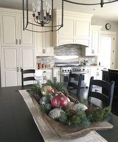 Antique dough bowl centerpiece with Christmas ornaments