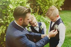 Image by Jess Petrie - Bride wore a beaded Lace Alexia Designs wedding gown to a vintage, rustic style wedding in the Kelham Island Museum, Sheffield. Groomsmen in navy suits.