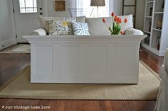 gorgeous DIY headboard using an old 4-panel door and crown moulding {our vintage home love}