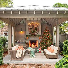 Bring the Holidays Outside - Glowing Outdoor Fireplaces Ideas - Southernliving. This backyard fireplace shows that any space can be perfect for an outdoor living space. It also creates additional space to decorate and entertain guests during the holiday season.