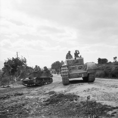 A Universal carrier and a Churchill tank of 51st Royal Tank Regiment during 6th Armoured Division's attack on the town of Pichon,  Tunisia 8 April 1943.