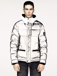 45561 MESH REFLECTIVE Hooded down jacket in Mesh Reflective. The historical Reflective Jacket, made in a highly refractive material owing to a coating made of thousand of glass microspheres, is layered on the outer side with an industrial feel nylon run-proof mesh which enhances the refracting qualities of the internal fabric creating optical and three-dimensional effects. Bape, Shape And Form, Stone Island, Padded Jacket, First World, Parka, Going Out, Ready To Wear, Style