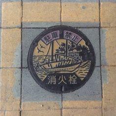Fire hydrant manhole cover. Place: Kuwana city, Mie, Japan.