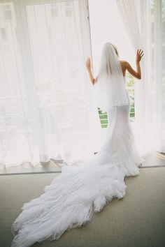 Wedding Gown by Inbal Dror | See more of the wedding on SMP: http://www.StyleMePretty.com/2014/03/07/lakeside-wedding-at-castle-maria-loretto/Photography: Thomas Steibl