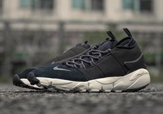 The Nike Air Footscape NM arrives in a clean black and grey colorway.