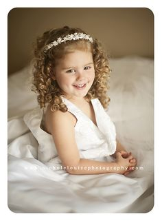 Little girl in moms wedding gown. Nichole Louise Photography