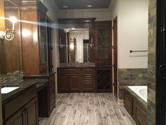 Master bath with 2 separate vanities, large soaker tub, and granite countertops.