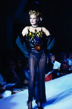 Karen Mulder wears a sheer black haute couture outfit with a multicolored metal bustier.  Thierry Mugler Autumn-Winter 1992-1993