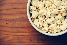 Sprinkle 2 tsp ground cinnamon + 1 tsp confectioners' sugar on 4 cups air-popped popcorn.    - WomansDay.com