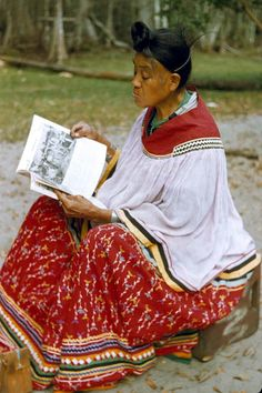Seminole woman reading at Big Cypress Reservaton Date: CA. 1958