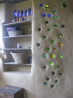 white wall with colorful glass bottles