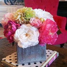 The combination of bright pink peonies, white hydrangea, and vibrant green dahlia makes this arrangement a must have. These high quality silk flowers give the i