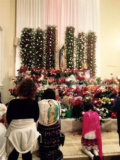 Participants celebrate the apparition of the Virgen de Guadalupe by attending the midnight mass.