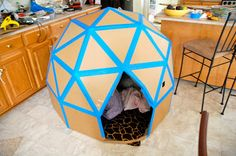 A tetrahedral dome made from recycled cardboard and duct tape. Neat alternative to a playhouse or teepee.