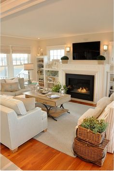 Living Room decor ideas - Neutral white & cream color palette, transitional coastal beach cottage style with fireplace and white trim.