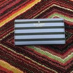 Kate Spade Wallet Used In Good Condition Kate Spade Wallet is used but in good condition. Has 12 credit card slots, 1 ID slot, and  zipper pocket for change.  Wallet measures 7 inches wide by 3.5 inches tall. Bags Wallets