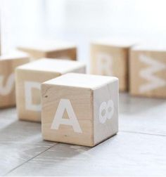 Alphabet wooden blocks by Ooh Noo. All the letters of the alphabet and numbers from 0 to 9 in their very own pure linen bag. Pram Toys, Dolls Prams, Wooden Alphabet Blocks, Wooden Blocks, Cubes, Scandinavian Toys, Baby Rocking Horse, Traditional Toys, Baby Girl Toys