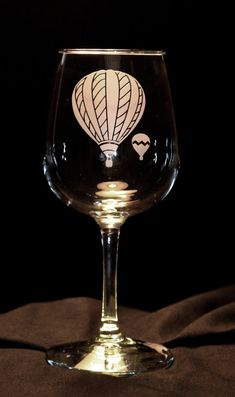 Hot Air Balloon Wine Glasses - Set of 2  These wine glasses are permanently etched with a very detailed hot air balloon. The design is