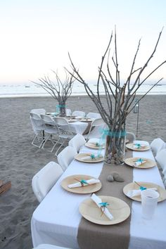 Pastel blues, rustic branches and simple setting for beach wedding