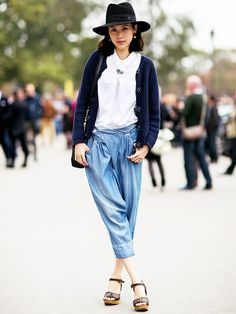 Wide-brim hat, white blouse, and trousers... - Street Style