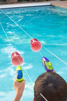 This elaborate obstacle course will be perfect for your nextnbsp;pool party. Your kids will love using squirt guns to move the cupsnbsp;across the pool.nbsp; Get the tutorial at This Grandma Is Fun.nbsp;