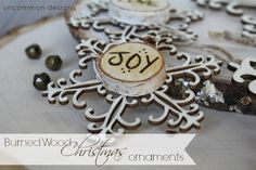 Create your own burned wood Christmas ornaments. So simple and beautiful! via www.uncommondesignsonline.com