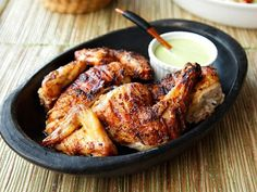 This Peruvian Style Grilled Chicken is a recipe I back-hacked from the awesome chicken and green sauce they serve at Pio Pio in NYC. The basics are simple: butterflied chicken with a vinegar and spice rub gets slow-cooked on the grill, followed by a quick stay directly over the coals to crisp the skin. It comes out tender and juicy and goes perfectly with a simple spicy and cream sauce made with jalapeños and aji amarillo peppers.