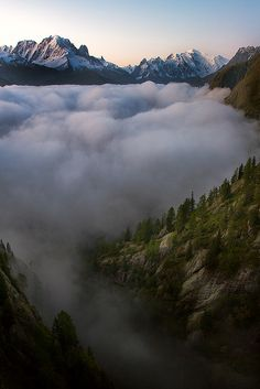 fog over lac d'emosson reservoir in the canton of valais, switzerland #nature #landscapes
