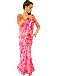 MAHI by designer Maahira from sobayha.com. Pure Chiffon Pink Tie and Dye Saree completed with Mirror work border all around and vibrant floral motif threadwork blouse. See more at: https://www.sobayha.com/catalogue/mahi_344/