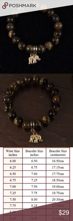 Tiger eye stretch bracelet with elephant One of a king, semiprecious stones. Discover power of tiger eye. Made for you with love. Unisex . Fits wrist size 6 Mangalinga Jewelry Bracelets
