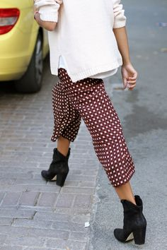 Printed pants and boots.