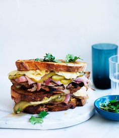 Gourmet Fast: Cuban mojo grilled pork sandwich recipe These quick meat-loaded Cuban sandwiches make for a hearty lunch. Add extra marinade on the side for more zing. Kubanisches Sandwich, Roast Beef Sandwich, Sandwich Recipes, Lunch Recipes, Gourmet Recipes, Gourmet Grill, Sandwich Board, Savoury Recipes, Breakfast Recipes