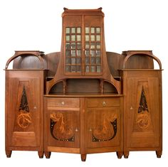 BERNARD PANKOK Jugendstil sideboard, 1900, carved American walnut with exotic wood inlays. | SOLD $162,150 Germany, 2007