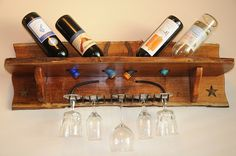 Natural edge Mesquite wine shelf.  Holds 4 bottles of wine with old rake incorporated as wine glass rack.
