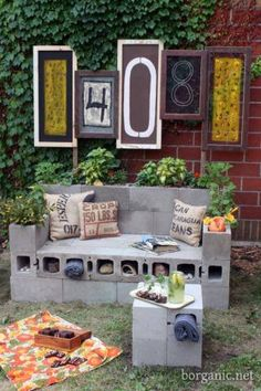 cinder block bench... I like the large house number art behind the bench