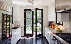 Timeless Kitchen Design | White Cabinets | Dark Wood Floor | Marble Worktops | Stainless Steel | Metal French Doors | Madeline Stuart, Designer