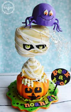 Cute! 3D sculpted, gravity defying Halloween Cake, Pumpkin, Mummy, and Spider by Maria Cazarez at Perfect Indulgence Cakes. All Edible, Visit me on Facebook, IG, Web.